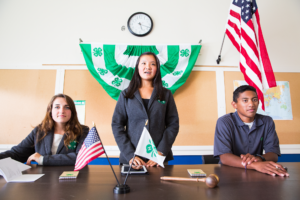 4-H members leading a meeting